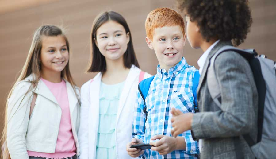 school friends meeting at school